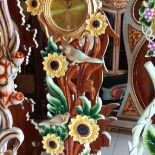 Lemari Jam Hias Bunga Matahari Bahan Kayu Jati